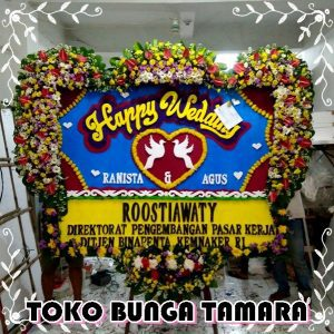 bunga papan happy wedding depok